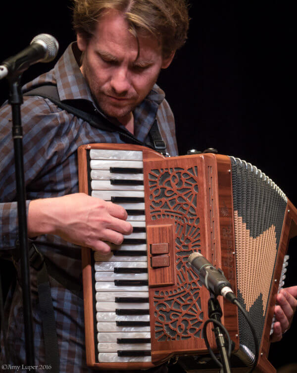 Nicholas Williams playing accordion
