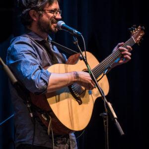 Yann Falquet playing guitar